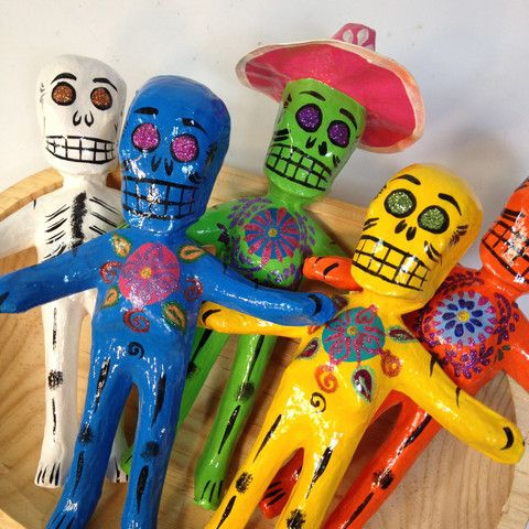 More skeletons! Day of the Dead is all about remembering the loved ones and the representation of those loved ones is done through skulls and skeletons. They are usually smiling and having fun doing what they loved to do in life. These happy guys are colorful and glossy. Handmade of