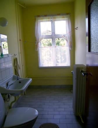 A very yellow bathroom, Æblegaarden B&B, Langeland, Denmark, Photo by Jacob Burén, www.aeblegaarden.dk