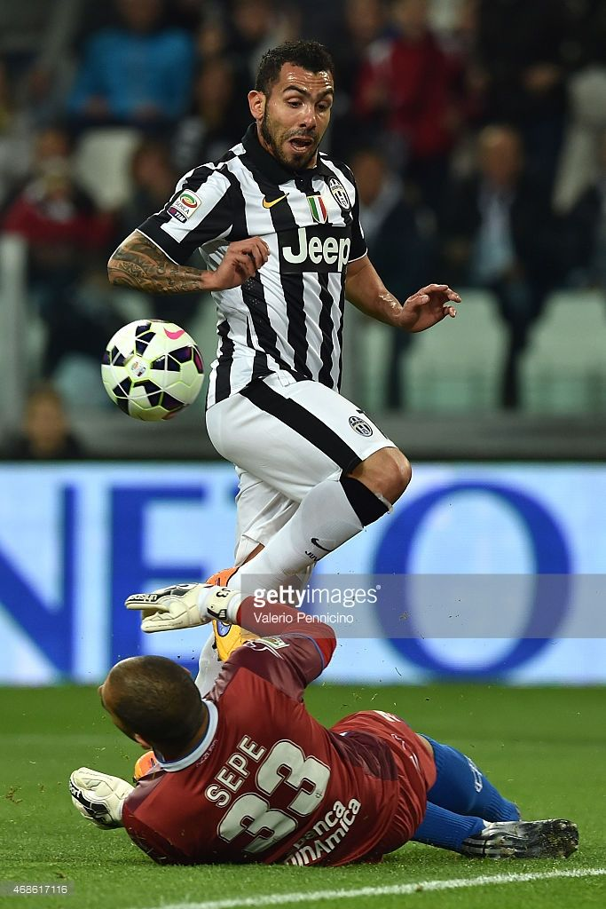 Carlos Tevez of Juventus FC clashes with Luigi Sepe of Empoli FC during the Serie A match between Juventus FC and Empoli FC at Juventus Arena on April 4, 2015 in Turin, Italy.