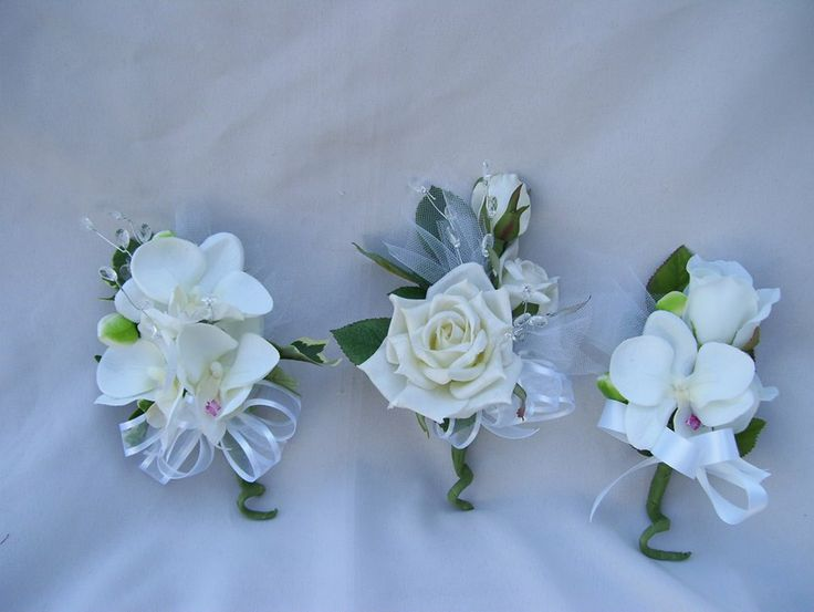 Three neutral corsages.  For prices and details, please visit our online store www.artisticfloraldesigns.com  For prices and details, please visit our online store www.artisticfloraldesigns.com — at Artistic Floral Design.