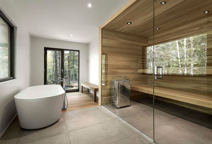 Bathroom with a wood sauna and a freestanding tub. Dear lord, I don't even sauna but I would start