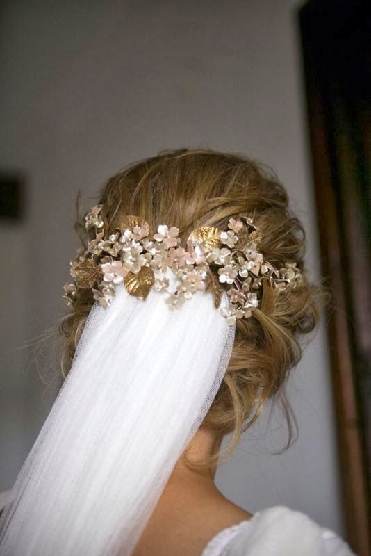 The flowers in a metallic gold hold in place a gorgeous veil for a modern take on a classic look.