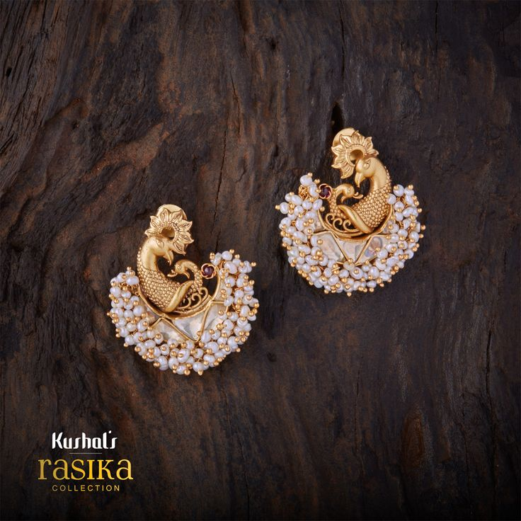 Peacock design rasika earring with a floral crown and several tiny pearl drops, plated with gold polish & made of pure silver.