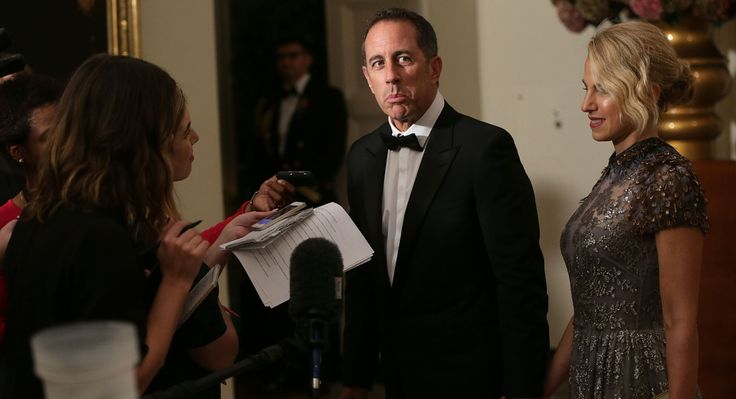 Comedian Jerry Seinfeld and his wife, Jessica Seinfeld, speak to members of the media as they arrive at the State Dinner. (Getty)