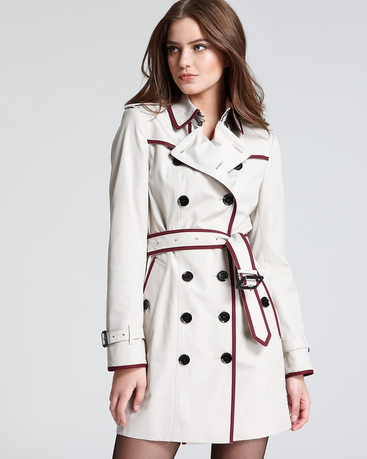 Black trench coat with white piping