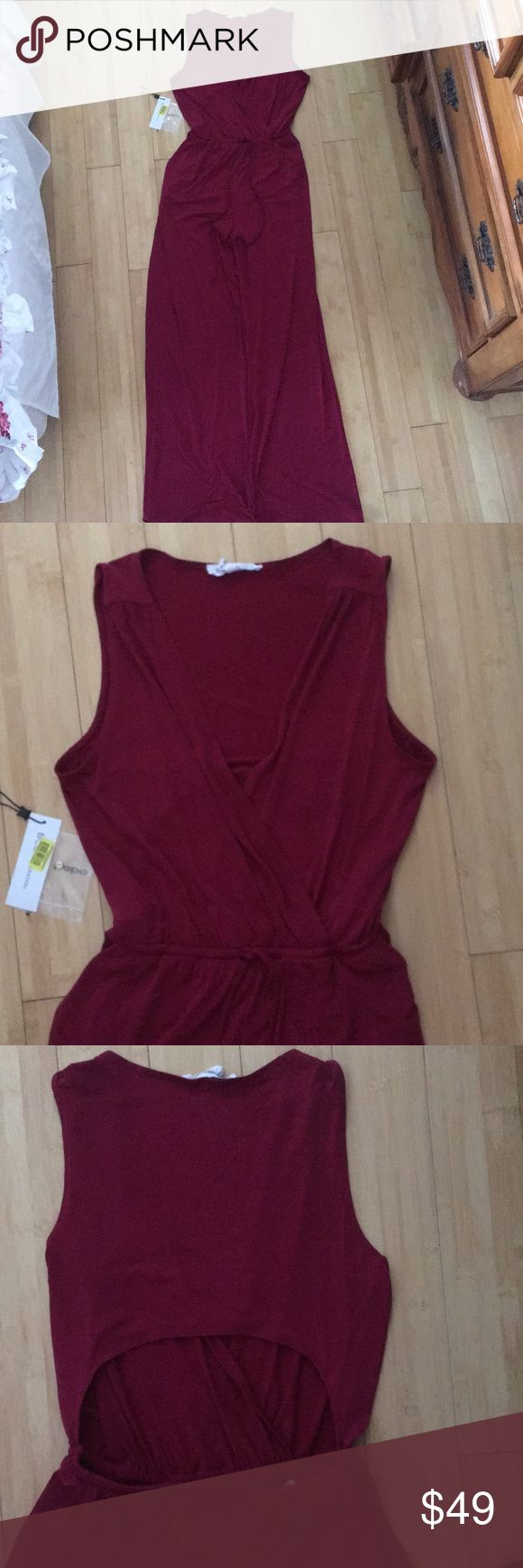 Bcbg long romper jumpsuit Gorgeous long romper, burgundy with detail cut out back excellent cond, tags included. BCBG Other