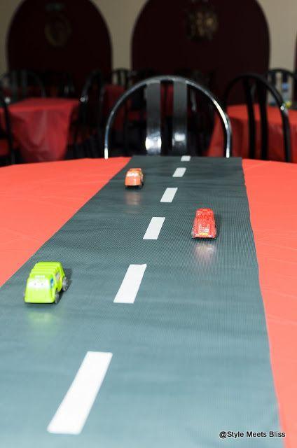 Table Arrangement- Transportation Theme  #transportationtheme #automobiletheme #transportationbirthday #cars #trucks #planes #trains #firstbirthday #vehiclestheme #vehicles #transportation #trafficsigns #handmadefans #decorativefans