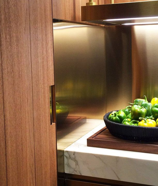 The hype for copper is (slightly) lessening and brass is rising as a trend tone. Both copper & brass are shown in lighter and darker variants, shiny or dulled, #kitchen surfaces #KitchenLiving #Eurocucina