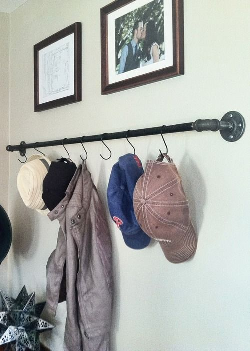 """DIY pipe shelf with """"S"""" hools for hanging hats, jackets, etc.  repurposed. industrial. home decor. design."""