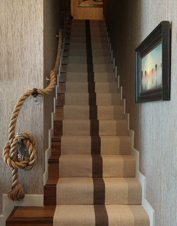 Chose heavy rope in place of a traditional railing for a nautical element. The runner was angled to reveal a hint of bare floor.