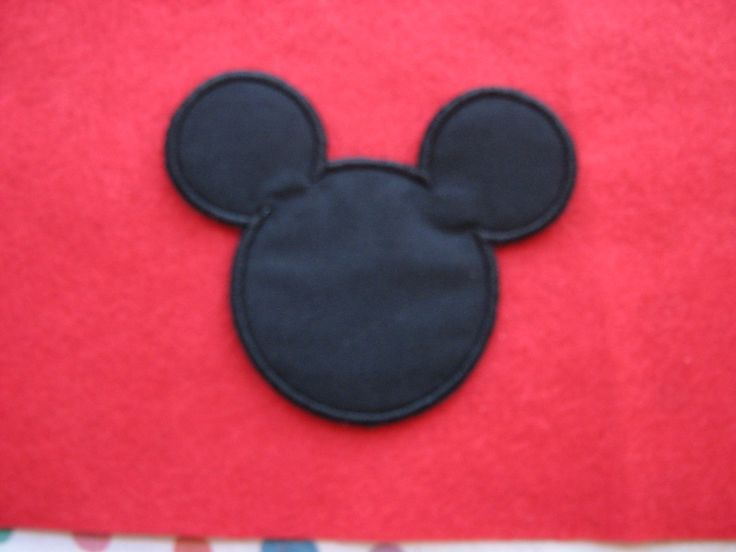 This cute Mickey Mouse iron on applique will look great on any item. Add it to a shirt, jeans, or a bag .These are also perfect for quilt blocks, Christmas stockings, tree skirts, fabric wrapped presents. Punch a hole in them use them as a gift tag. The possibilities are endless.  Measures :  3 1/2 inches long x 3 3/4 inches wide  If you would like more quantity please let me know, I can always make more of the appliques and patches you see in my store. I also have tons of other des...