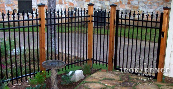 Aluminum Fence Mounted to Stained Wood Posts