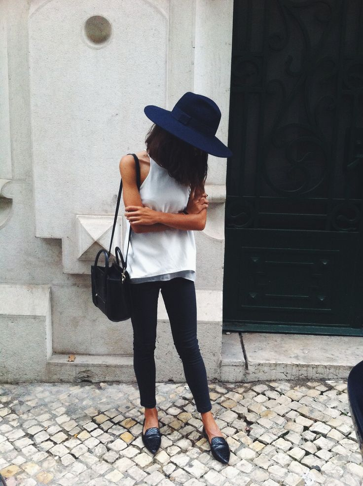 navy hat, white tank top, black skinnies, black purse and black pointed toe loafers.