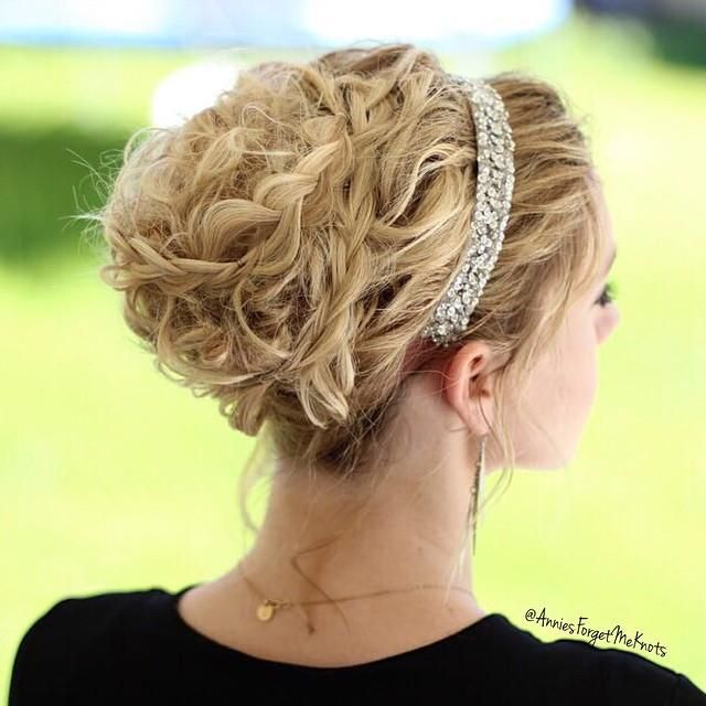 Crazy Left Over Curls In A High Bun With Some Added Braids