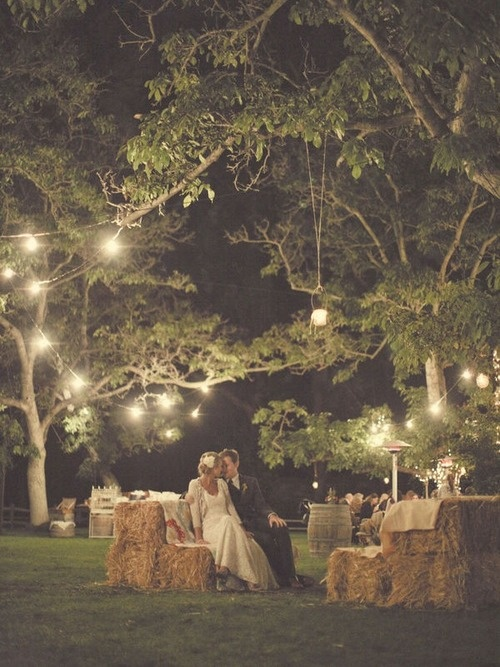 Haybale couches at a beautiful rustic wedding.