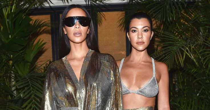 Kourtney and Kim Kardashian showed lots of skin in matching metallic outfits at the Balmain afterparty in Paris on September 29 — see the sultry pics!