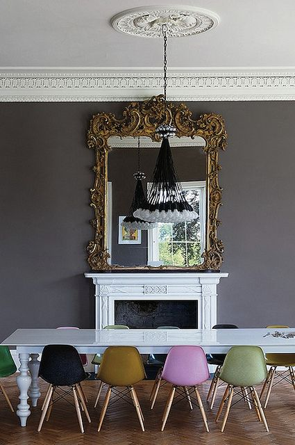 Combining Old And New: Eames Plastic Chairs In Front Of A Classic  Fireplace. Ilse