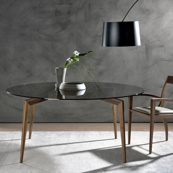 Hope is a contemporary Italian dining table design from Pacini e Cappellini. The round or square glass top extends over the sleek, solid walnut or ash base.