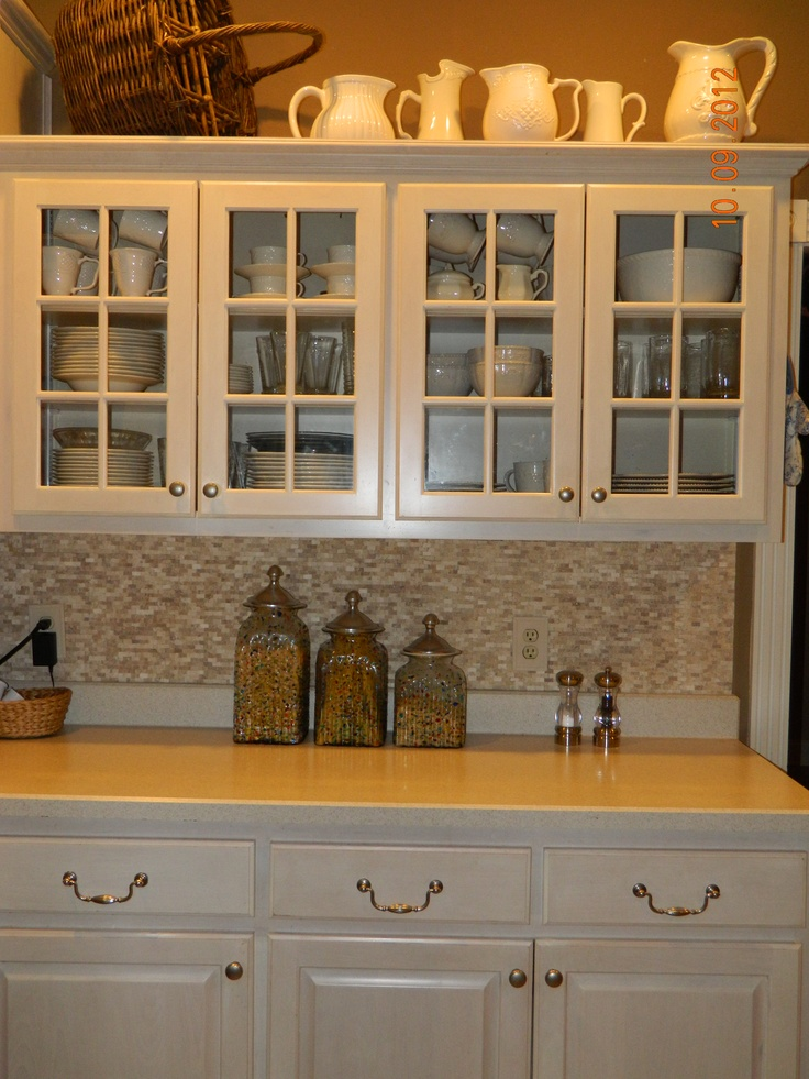 Glass Cabinet Doors, Cream Colored Dishes, Small Stone Backsplash (Loweu0027s),  Brown Walls, Cream Colored Collection Of Stoneware Pitchers