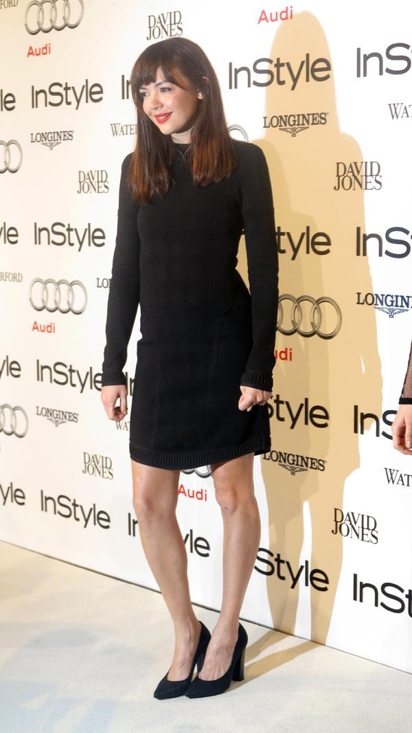 Actress Emma Lung walks the white carpet.