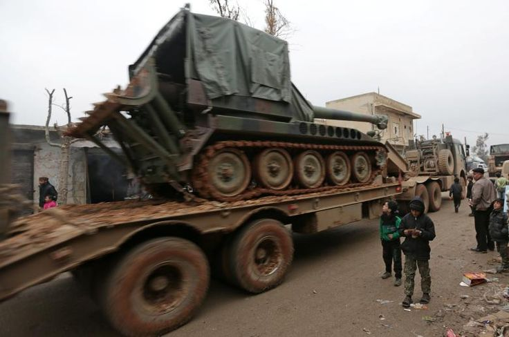 Turkish military vehicles drive in the northern Syrian rebel-held town of al-Rai, Syria January 5, 2017. REUTERS/Khalil Ashawi