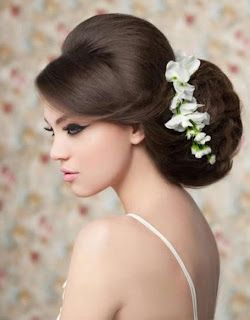 This bridal hairstyle is beautiful. With the make-up, there's something very 60's about this look.