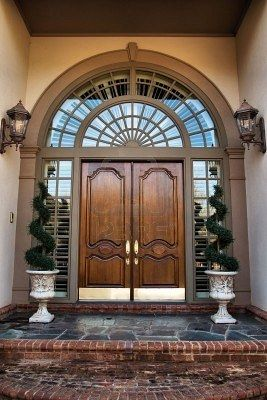 Simple double front stained door with a lot of symmetry.