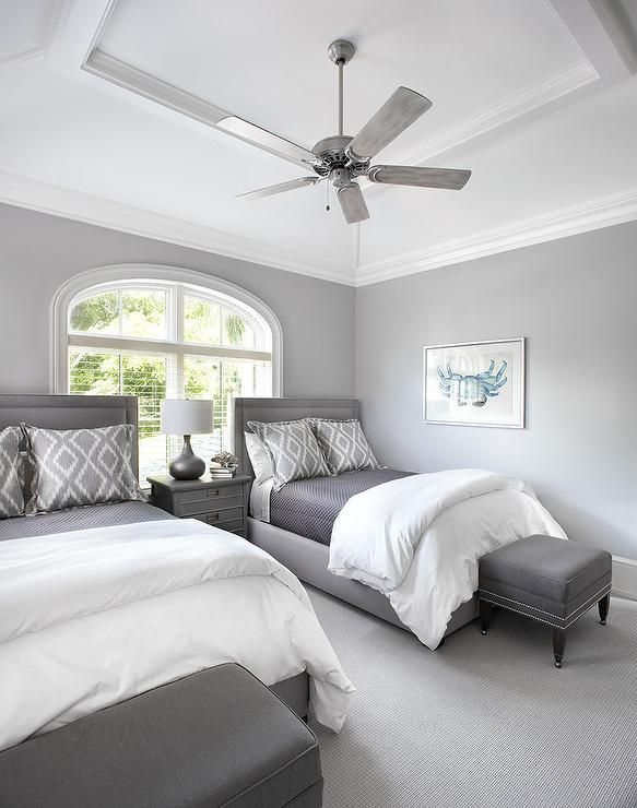 A Ceiling Fan Mounted To A Vaulted Tray Ceiling Hangs Over