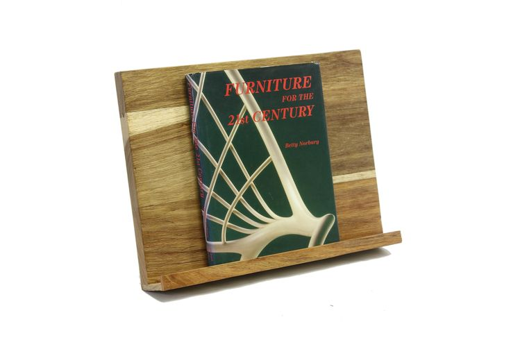a book stand is ideal to hold recipes in the kitchen ...or display that volume that's too beautiful to hide on the shelf.