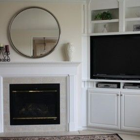 built ins with TV beside fireplace - with room for dvd and cable box