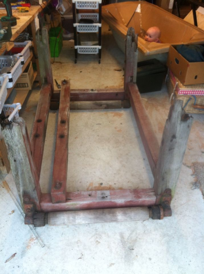 Piece of old wooden frame from a farm, a scrub, a rub, a polish and a trim then just need to find some thick shatterproof glass for the top and we're in business