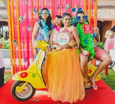 Photobooths are the hottest thing to happen to Indian mehendi's since 'Mela themes' came around. The bride, her friends, some crazy props, and a cool backdrop for your photog to click away as you p...