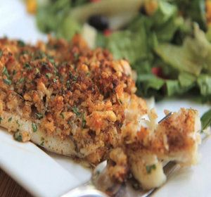 Seasoned tilapia topped with a golden, parmesan-breadcrumb crust. Easy, quick and tried and true! This baked parmesan tilapia recipe is company worthy but weekday friendly! I've never tried it on chicken but I plan on doing that next since I just love the taste of that crumb mixture.