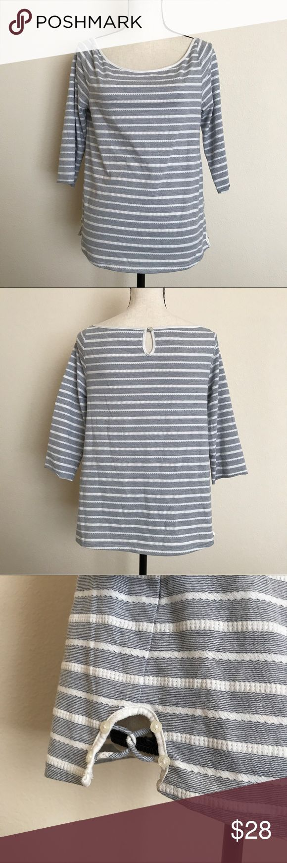 Postmark Anthropologie Nautical Striped Top Great Pre-Owned Condition. Blue and White Stripes. Has a Nautical look to it. Cute cross accents on the sides. Anthropologie Tops Tees - Long Sleeve