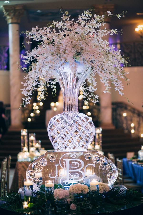 monogrammed ice sculpture centerpieces are perfect for winter weddings via wwwsouthernbrideandgroomcom