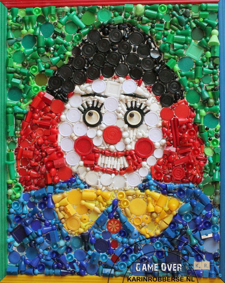 Kringloop mozaiek schilderij van spelletjes afval