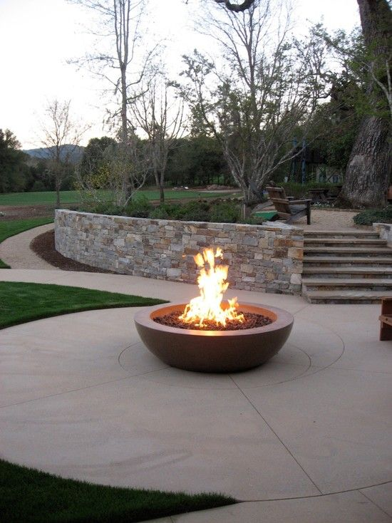 a fire pit makes a great design element for your backyard or patio we have a collection of outdoor fire pit design photos for inspiration