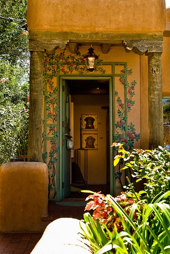 A beautiful door surroundedwith carvings invotes you in. Santa Fe, New Mexico