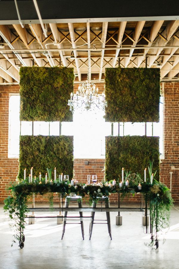 moss wall backdrop - photo by Emily Sacco Photography http://ruffledblog.com/urban-garden-party-wedding
