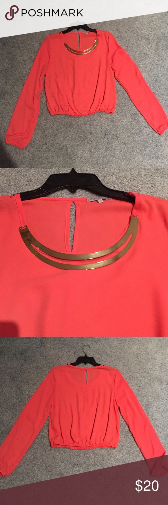 Coral Blouse with Gold Accent Necklace Really cute coral shirt that has a built in gold necklace! ONLY WORN ONCE!!! Charlotte Russe Tops Blouses