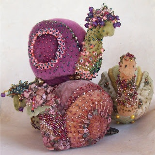 Oh! snails! love the encrusted beadwork on wool felt(?).....looks to be shaded