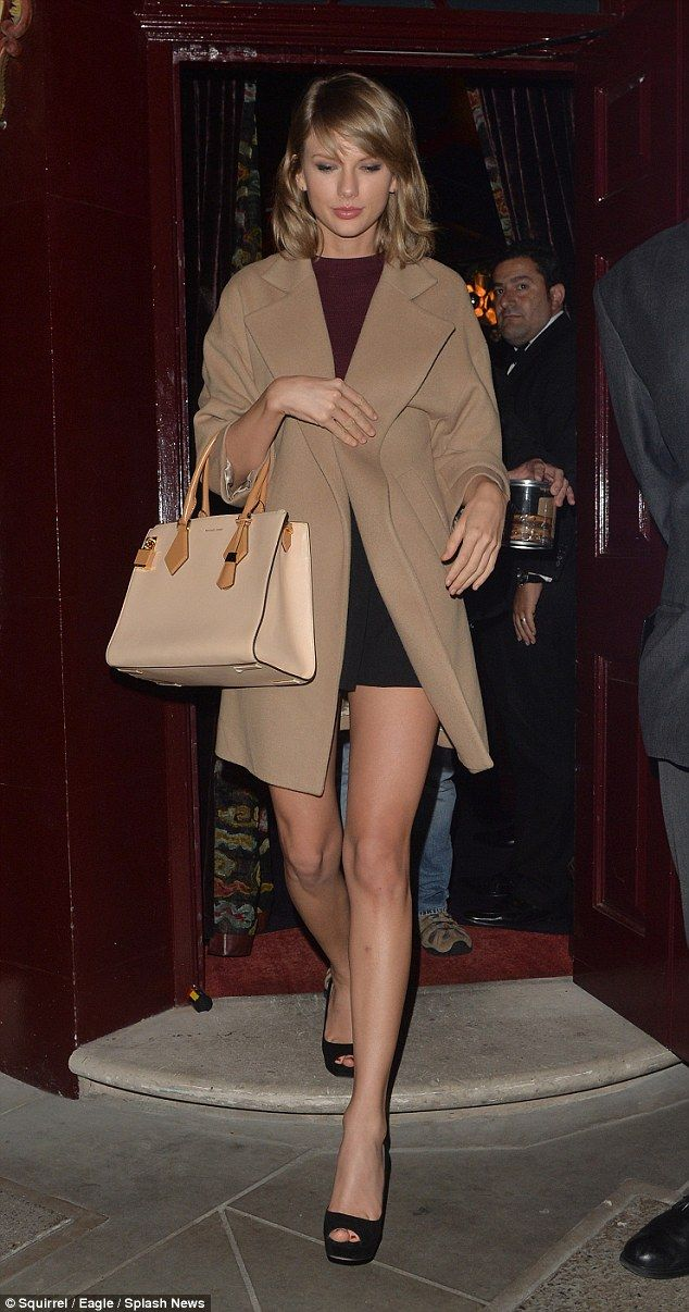 On point: Taylor Swift looked stylish in a camel coat and black shorts as she hit the town in London after her sold-out Barclaycard Presents British Summer Time concert in Hyde Park