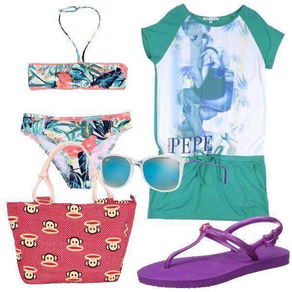 Per una giornata di divertimento in spiaggia con le amiche: bikini in fantasia floreale, in abbinato il vestito a mezze maniche in jersey, color verde con stampa, multitasche e coulisse. Borsa a mano in fantasia rossa con manici corti in corda. Sandali in gomma viola con cinturino e logo. Occhiali da sole con lenti a specchio.