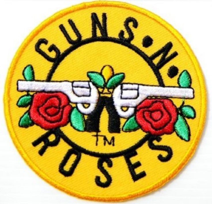 This embroidered Guns N Roses patch displays the band's famous dueling guns logo surrounded by roses. The yellow cloth patch contains attractive multicolored embroidery. The Guns N Roses band name is