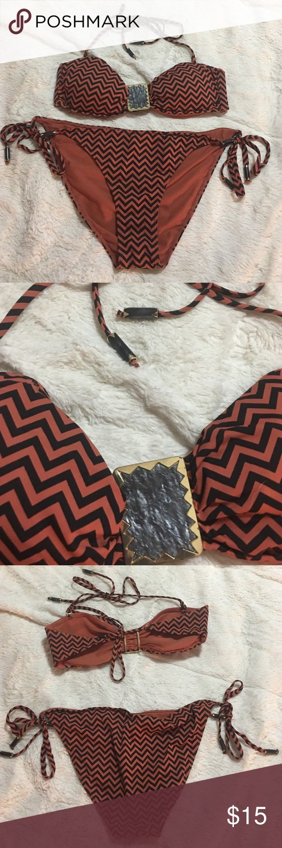 H&M brown black chevron bikini Size 10&12 Selling one black and brown chevron H&M bikini. The bikini top is a size 10, has a decorative clasp upfront, and beads on end of strings. Ties around neck and back. The bikini bottoms are a size 12 and also have the beads that match the top one ends of strings. Ties on each hip. H&M Swim Bikinis