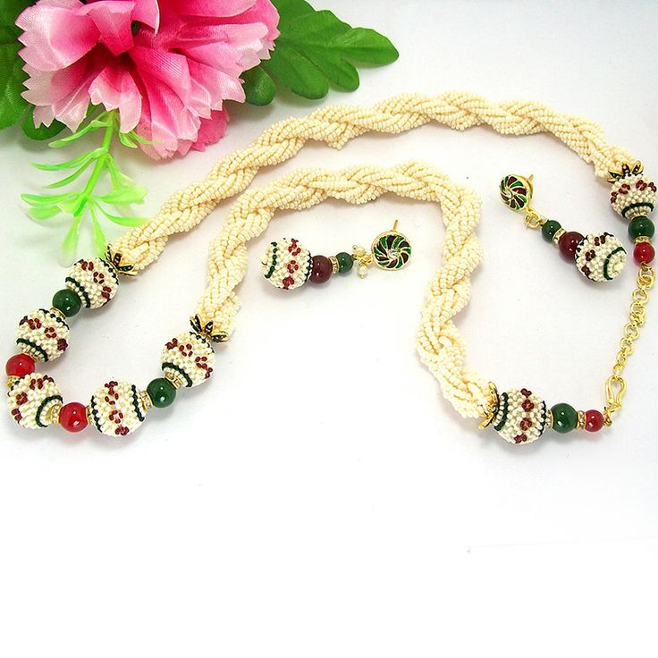 This antique chid mala is based on twisted pearl seeds series strings in order to provide a designer cum antique look to it. The lower base of the mala is highlighted with tri color jaal puwai balls separated by color balls and golden octan stone separators.