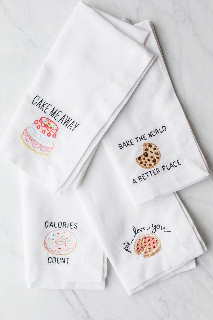 "Set of four iconic baked goods lover embroidered designs including ""Cake me away, Calories (donut) count, Bake the world a better place, Pie love you"" on 100% cotton napkins with mitered corners and 1"