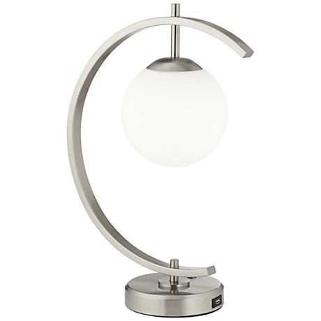 An arched led desk lamp with integrated usb port in the base allows you to charge
