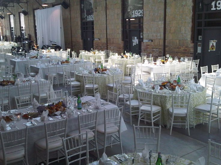 """White Chiavari Chair with White Leatherette Seat, Gallery Tables 42"""" Wide, Regency Silver Flatware, Glass Oceana China, Standard Glassware, Green Leaf Organza, White Crinkle Linen, White Frette Linen   Chair-man Mills, Venue: Artscape, Wychwood Barns"""