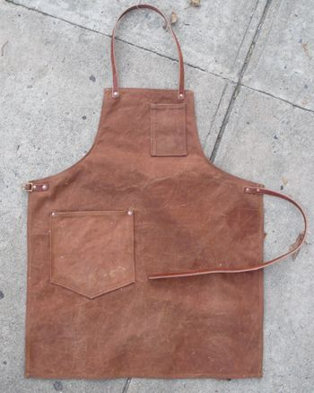 Coolest leather apron ever. No man should have to wear a frilly dilly apron in the kitchen. This apron--means business.